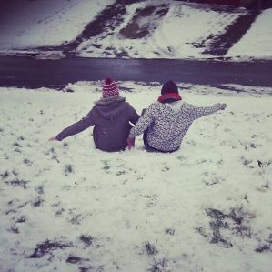 Snow Sledding backwards